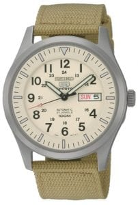 Seiko 5 Sports Automatic Military Cream Canvas Mens Watch SNZG07K1Driven by a 21-jewel automatic movement, this Seiko 5 Sports Automatic Cream Canvas Mens Watch SNZG07K1 has a classic military style to it with the canvas and cream combination. In terms of the cream dial, 12 and 24 hour indexes can be found around the outer rim. The ever present Seiko 5 logo sits just below the 24 hour index with a day and date window taking the place of the 3 o'clock position. This old school dial is protected by a silver stainless steel case and hardlex crystal glass. Adding to this retro feel, a cream canvas strap fits around ones wrist and fastened by a buckle clasp.This watch has a water resistance of 100 metres, making it suitable for swimming and snorkeling, but should not be used for any form of recreational diving. Key Features:Exclusive 7S36B Calibre23 Jewel Automatic MovementLuminous Hands & MarkersDay & Date DisplayCream DialCream Canvas StrapStainless Steel CaseSports Watch100m Water ResistantHardlex CrystalSee Through Case Back The Family: Seiko 5The Seiko 5 family has set the standard in affordable, rugged and stylish watches since 1963. Designed to be simple but serious, the Seiko 5 is so-called due to its five key attributes: automatic winding, displaying the day and date in a single window, water resistance, a recessed crown at the 4 o'clock position and a durable metal bracelet. Released in order to meet the demands of the revolutionary baby-boomer generation, the Seiko 5 collection is just as popular to this day, proof that expert craftsmanship and elegant design will never go out of fashion. The Brand: SeikoSeiko's 135-year history has been marked by a ceaseless determination to innovate in every aspect of the watchmaker's art. By embracing this mantra, Seiko has been responsible for a string of industry-leading advances in the technology of time, such as the world's first quartz watch, the world's first TV watch, and the Seiko Kinetic, the first watch ever to generate its own electricity from the movement of the wearer. Seiko are unique in that they manufacture every aspect of every watch in-house, with this ruthless pursuit of perfection even including growing their own quartz crystals and sapphires.