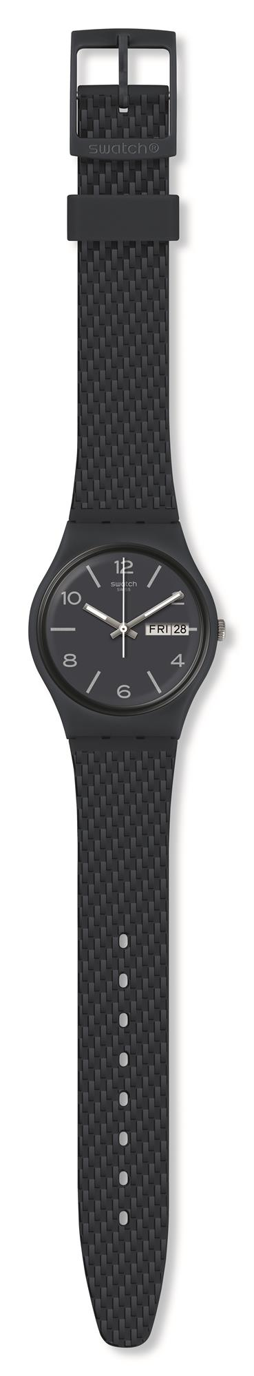 Swatch Bau Laserata Dark Blue Silicone Strap Quartz Day Date Men's Watch GN725 34mmThis Swatch Bau Laserata Dark Blue Silicone Strap Quartz Day Date Men's Watch GN725 34mm has a sleek design with a silvery print. A dark blue dial is complimented by silver Arabic indexes and hands, which in turn are powered by a quartz movement. At the 12 o'clock position is the ever present Swatch logo with a simplistic day and date window at the 3 o'clock position. Surrounding the dial is a plastic case and glass ontop to increase the strudiness of the timepiece. Finally, a silicone strap can be fastened using a standard buckle.This watch has a water resistance of 30 metres, making it suitable for light splashes.Key Features:Bau CollectionLaserata ModelDark Blue Silicone StrapDark Blue Dial30m Water ResistantQuartz MovementDrak Blue Plastic CaseStandard BuckleDay Date WindowThe Family: BauThe Bau collection is inspired by the Bauhaus movement, a design genre that focuses on geometric shapes and primary colours. The collection refects those concerns and explores the possibilities of graphic design and colours while projecting a joyful, dynamic and very neat feel.The Brand: SwatchSwatch watches are globally-renowned for their trademark combination of quality Swiss watchmaking, pioneering use of plastic cases and straps, and eye-catching designs. There is a Swatch watch to suit every age, taste and lifestyle, with this variety and sense of difference ensuring that Swatch watches remain some of the most popular and sought after currently manufactured.