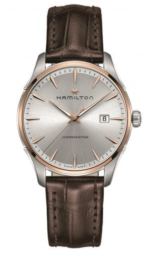 """Hamilton Jazzmaster Rose Gold Steel Case Leather Strap Mens Watch H32441551 40mmThis Hamilton Jazzmaster Rose Gold Steel Case Leather Strap Mens Watch H32441551 40mm is a stunning addition to the Hamilton brand. This metallic silver dial is complimented by rose gold stainless steel hands and indexes. Sat below the 12 o'clock position is the Hamilton logo as well as the brand name. The date window is positioned at the 3 o'clock position of the watch. Above the 6 o'clock position is the name of this timepiece, the Jazzmaster. To protect this dial, sapphire crystal glass and rose gold stainless steel case sit next to the dial. This watch also features a brown leather strap which is fastened using a deployment clasp. This watch has a water resistance of 50 metres, making it suitable to be subjected to light splashes.Key Features:Quartz Movement50m Water ResistantSapphire Crystal GlassBrown Leather StrapDate WindowSilver Coloured DialDeployment ClaspAnalogue DisplayPolished FinishThe Family: JazzmasterMuch like jazz itself, the Hamilton Jazzmaster family contains several unique and outstanding variations on a theme. Ranging from pieces defined by their understated elegance and simplicity to bold statement watches, the Jazzmaster collection is as varied and as personal as the form of musical expression from which it takes its name.The Brand: HamiltonSince its foundation in 1892, Hamilton Watch Company have developed a reputation for being a provider of accurate timekeeping. Hence they earned the title of """"The Watch of Railroad Accuracy"""", as a result of their highly accurate pocket watches.Hamilton earned a place in history, as they found themselves suppliers of watches to the US military in both world wars. The US Naval Lab invited the Hamilton Watch Company to create an American made chrono.There was a shortage of chronos available to the US Government during the First World War. Therefore they had to rely solely on European made pieces. For this reason Hamilton agreed i"""