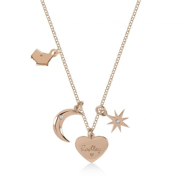 Radley Heart Rose Gold PVD Sterling Silver Czech Stone Charms Necklace RYJ2044This Radley Heart Rose Gold PVD Sterling Silver Czech Stone Charms Necklace RYJ2044 is the perfect addition to any jewellery set. A rose gold PVD sterling silver chain link is finished off with four wonderful charms. The charms include; the Radley dog, heart, crescent moon & a polished star. Key Features:Heart CollectionSterling SilverCharms (Dog, Heart, Moon, Star)The Brand: RadleyWe are a London born brand that has a passion for crafting beautiful handbags and accessories that women love. Our approach is simple – to create the perfect combination of style on the outside and functionality on the inside. To achieve this we blend creative design, quality materials and immaculate craftsmanship, not forgetting plenty of personality to finish. We hope you enjoy exploring our world…