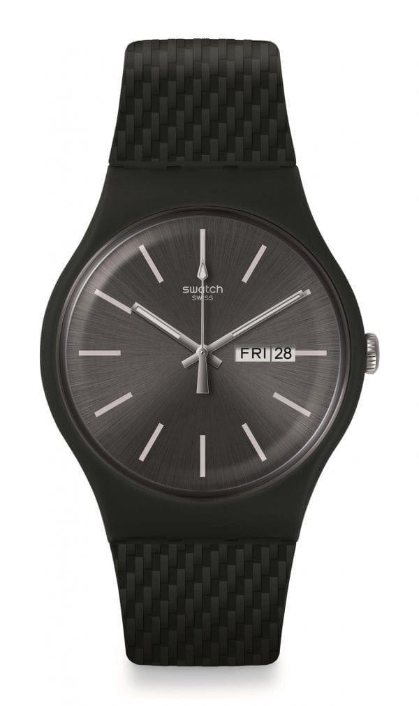 Swatch Bau Bricagris Silicone Strap Quartz Day Date Men's Watch SUOM708 41mmThis Swatch Bau Bricagris Silicone Strap Quartz Day Date Men's Watch SUOM708 41mm featires a dark and stromy sun-brushed black dial. The dial is complimented by silver coloured indexes and hands, which in turn are powered by a quartz movement. At the 12 o'clock position is the ever present Swatch logo with a simplistic day and date window at the 3 o'clock position. The dial is then surrounded by a black plastic case and plastic glass. Finally, a black textured silicone strap can be fastened using a standard buckle.This watch has a water resistance of 30 metres, making it suitable for light splashes.Key Features:Bau CollectionBricagris ModelBlack Silicone StrapBlack Dial30m Water ResistantQuartz MovementBlack Plastic CaseStandard Buckle Day DateThe Family: BauThe Bau collection is inspired by the Bauhaus movement, a design genre that focuses on geometric shapes and primary colours. The collection refects those concerns and explores the possibilities of graphic design and colours while projecting a joyful, dynamic and very neat feel.The Brand: SwatchSwatch watches are globally-renowned for their trademark combination of quality Swiss watchmaking, pioneering use of plastic cases and straps, and eye-catching designs. There is a Swatch watch to suit every age, taste and lifestyle, with this variety and sense of difference ensuring that Swatch watches remain some of the most popular and sought after currently manufactured.