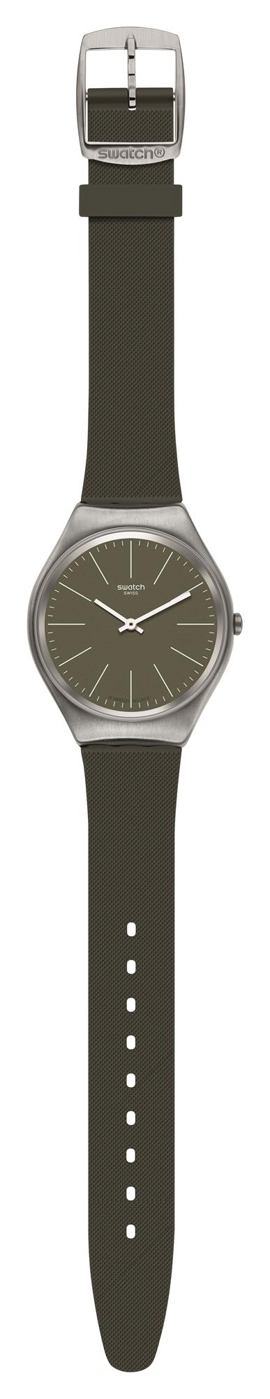 Swatch Skin Irony Skinnature Khaki Green Mens Watch SYXS116 38mmThisSwatch Skin Irony Skinnature Khaki Green Mens Watch SYXS116 38mm is a superb addition to the Skin Irony collection. White indexes and hands are complimented by a khaki green dial. The hands are powered by a quartz movement and protected by a stainless steel case. A green khaki silicone strap is then fastened using a standard buckle.This watch has a water resistance of 30 metres, making it suitable for light splashes.Key Features:Khaki Green DialKhaki Green Silicone StrapStandard BuckleQuartz Movement30m Water ResistantStainless Steel CaseThe Brand: SwatchSwatch watches are globally-renowned for their trademark combination of quality Swiss watchmaking, pioneering use of plastic cases and straps, and eye-catching designs. There is a Swatch watch to suit every age, taste and lifestyle, with this variety and sense of difference ensuring that Swatch watches remain some of the most popular and sought after currently manufactured.