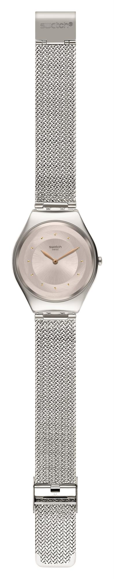 Swatch Skin Irony SkinSand Milanese Mesh Bracelet Ladies Watch SYXS117M 38mmThisSwatch Skin Irony SkinSand Milanese Mesh Bracelet Ladies Watch SYXS117M 38mm is a superb addition to the skin irony collection. The dial has a metallic pink colour to it. Around the edge of the dial are golden sparkles used as indexes with hands powered by a quartz movement. Just below the 12 o'clock index is the classic Swatch logo. Surrounding the dial is a polished silver stainless steel case. To equip this watch a beautiful silver stainless teell mesh milanese bracelet is fastened using a standard buckle.This watch has a water resistance of 30 metres, making it suitable for light splashes.Key Features:Silver Stainless Steel Mesh Milanese BraceletStandard BucklePink Dial30m Water ResistantQuartz MovementSilver Stainless Steel CaseThe Brand: SwatchSwatch watches are globally-renowned for their trademark combination of quality Swiss watchmaking, pioneering use of plastic cases and straps, and eye-catching designs. There is a Swatch watch to suit every age, taste and lifestyle, with this variety and sense of difference ensuring that Swatch watches remain some of the most popular and sought after currently manufactured.