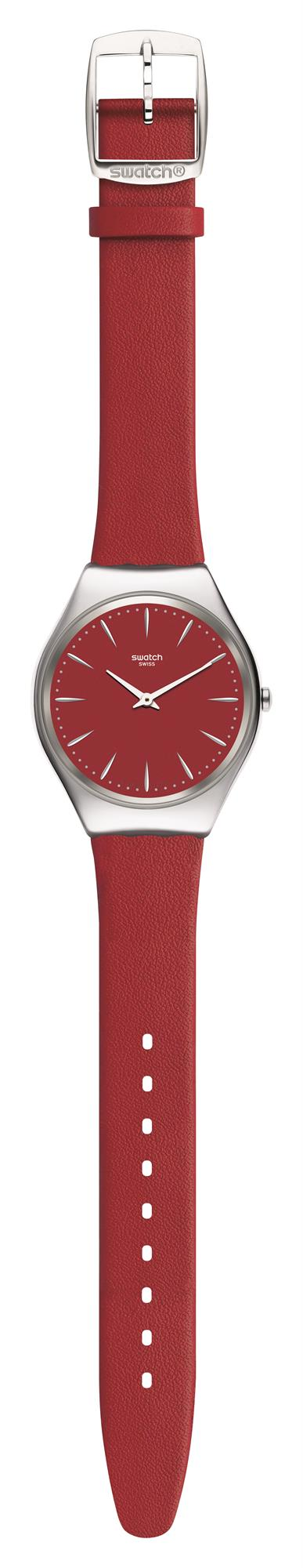 Swatch Skin Irony Skinrossa Red Leather Strap Ladies Watch SYXS119 38mmThis Swatch Skin Irony Skinrossa Red Leather Strap Ladies Watch SYXS119 38mm is a superb addition to the skin irony collection. A red dial is complimented by silver coloured indexes and white hands, which are powered by a quartz movement. To protect the dial, a stainless steel case and plastic glass sit around the dial. To equip this timepiece a red leather strap is fastened by a standard buckle to sit comfortably around ones wrist. This watch has a water resistance of 30 metres, making it suitable for light splashes. Key Features:Red Leather StrapSkin Irony CollectionRed DialQuartz Movement30m Water ResistantStainless Steel CaseStandard BuckleThe Brand: SwatchSwatch watches are globally-renowned for their trademark combination of quality Swiss watchmaking, pioneering use of plastic cases and straps, and eye-catching designs. There is a Swatch watch to suit every age, taste and lifestyle, with this variety and sense of difference ensuring that Swatch watches remain some of the most popular and sought after currently manufactured.