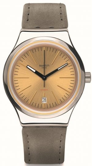 """The Watch: Swatch Sistem Sand 42mm Case Automatic Ladies Fall Winter Watch YIS411This Swatch Sistem Sand Automatic Unisex Watch (YIS411) packs serious watchmaking substance into an elegantly understated design, as a cleanly styled sun-brushed gold-coloured dial and grey leather strap is teamed with an intricate automatic movement.Key Features:SISTEM51 Automatic MovementOpen Case BackDate WindowLeather StrapLuminous HandsWater Resistant to 30mThe Brand: SwatchSwatch watches are globally-renowned for their trademark combination of quality Swiss watchmaking, pioneering use of plastic cases and straps, and eye-catching designs. There is a Swatch watch to suit every age, taste and lifestyle, with this variety and sense of difference ensuring that Swatch watches remain some of the most popular and sought after currently manufactured.Who We AreWatchNation is proud to be an authorized, established and respected supplier of Swatch watches. We stock a broad and exciting range of these superb timepieces both online and in store. Visiting us in store, located at 15-17 Charles Street, Hoole, Chester, CH2 3AZ, gives you the opportunity to take a first-hand look at our fantastic range of high-quality timepieces, with our friendly team of staff always on hand to use their decades of experience to offer helpful advice, useful information and expert guidance. If you can't pay a visit to our store, then our online delivery service guarantees that your latest timepiece will go from checkout to your wrist in a fast and reliable manner. These services are all a product of the motto on which WatchNation was founded and will forever operate – """"Time for the People."""""""