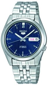 Seiko 5 Automatic Blue Dial Stainless Steel Men's Watch SNK357K1Driven by a 21-jewel automatic movement, this Seiko 5 Automatic Blue Dial Stainless Steel Men's Watch (SNK357K1) also features a day-date window and a sleek stainless steel bracelet and case. Key Features:Exclusive Seiko 7S26 Calibre21-Jewel Automatic MovementLuminous Hands and MarkersOpen Case BackDay-Date WindowWater Resistant to 30m The Family: Seiko 5The Seiko 5 family has set the standard in affordable, rugged and stylish watches since 1963. Designed to be simple but serious, the Seiko 5 is so-called due to its five key attributes: automatic winding, displaying the day and date in a single window, water resistance, a recessed crown at the 4 o'clock position and a durable metal bracelet. Released in order to meet the demands of the revolutionary baby-boomer generation, the Seiko 5 collection is just as popular to this day, proof that expert craftsmanship and elegant design will never go out of fashion. The Brand: SeikoSeiko's 135-year history has been marked by a ceaseless determination to innovate in every aspect of the watchmaker's art. By embracing this mantra, Seiko has been responsible for a string of industry-leading advances in the technology of time, such as the world's first quartz watch, the world's first TV watch, and the Seiko Kinetic, the first watch ever to generate its own electricity from the movement of the wearer. Seiko are unique in that they manufacture every aspect of every watch in-house, with this ruthless pursuit of perfection even including growing their own quartz crystals and sapphires.