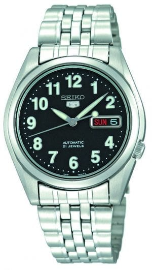 Seiko 5 Automatic Black Dial Silver Stainless Steel Men's WatchThis Seiko 5 Automatic Black Dial Silver Stainless Steel Men's Watch is a classic addition to the Seiko 5 family. A black dial is complimented by silver hands and indexes. The hands are powered by an exclusive 7S26 21 jewel calibre automatic engine to keep the watch in perfect time. A day and date window appear at the 3 o'clock with the Seiko 5 logo just below the 12 o'clock position. A silver stainless steel case surrounds the dial with hardlex crystal glass sitting on top. A silver stainless steel bracelet can then be fastened using a simple fold over clasp.Finally, this watch has a water resistance of 30 metres, making it suitable for light splashes.Key Features:Exclusive Seiko 7S26 Calibre21-Jewel Automatic MovementLuminous Hands and MarkersOpen Case BackSpeedometer DialDay-Date WindowWater Resistant to 30mThe Family: Seiko 5The Seiko 5 family has set the standard in affordable, rugged and stylish watches since 1963. They incorporate simplicity, but seriousness. The name of the Seiko 5 derives from its five key attributes, which Seiko promised to include in every watch that belonged to the family. They are: automatic winding, displaying the day and date in a single window, water resistance, a recessed crown at the 4 o'clock position and a durable metal bracelet.1963 marked the year that the Seiko 5 acted as a catalyst in the horological revolution in automatic watchmaking. Even after being in the market for over 50 years, albeit the Seiko 5 still remains as cool and relevant as ever. Though this serves as proof that expert craftsmanship and elegant design will never go out of fashion.The Brand: SeikoCeaseless determination to innovate in every aspect of the watchmaker's art is what defines Seiko's 135-year history. By embracing this ethos, Seiko has been responsible for a string of industry-leading advances in the technology of time. Notably, the creation of the world's first quartz watch in 1969. Or