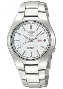 Seiko 5 Automatic White Dial Silver Stainless Steel Men's WatchDriven by a 21-jewel automatic movement, this Seiko 5 Automatic White Dial Silver Stainless Steel Men's Watch is a perfect addition to the wrist. At the 12 o'clock position is the ever present Seiko 5 logo with a day and date window at the 3 o'clock position. The hands of which are powered by an automatic movement are coated in a luminous material for easy visibility at night. Surrounding the dial is a silver stainless steel case to provide the dial with some protection. On the flip of the dial is an open case back window which allows you to see all the inner workings of the timepiece. Finally, a silver stainless steel bracelet can be fastened using a deployment clasp.This watch has a water resistance of 30 metres, making it suitable for light splashes.Key Features:Exclusive Seiko 7S26 Calibre21-Jewel Automatic MovementDay-Date WindowWater Resistant to 30mOpen Case BackWhite DialSilver Stainless SteelDeployment ClaspAnalogue DisplayThe Family:The Seiko 5 family has set the standard in affordable, rugged and stylish watches since 1963. They incorporate simplicity, but seriousness. The name of the Seiko 5 derives from its five key attributes, which Seiko promised to include in every watch that belonged to the family. They are: automatic winding, displaying the day and date in a single window, water resistance, a recessed crown at the 4 o'clock position and a durable metal bracelet. 1963 marked the year that the Seiko 5 acted as a catalyst in the horological revolution in automatic watchmaking. Even after being in the market for over 50 years, albeit the Seiko 5 still remains as cool and relevant as ever. Though this serves as proof that expert craftsmanship and elegant design will never go out of fashion.The Brand: SeikoCeaseless determination to innovate in every aspect of the watchmaker's art is what defines Seiko's 135-year history. By embracing this ethos, Seiko has been responsible for a string of industry-leading advances in the technology of time. Notably, the creation of the world's first quartz watch in 1969. Or equally impressive the creation of the world's first TV watch in 1982. And even more relevant today, with our abhorrent use of non-renewable energy sources, Seiko's Kinetic. This watch had the ability to generate its own power from the movement of the wearer, it was released in 1988. The listed technological developments serve as evidence to illustrate the revolutionary impact which Seiko has had on the watchmaking world. They are also remarkably unique in that they manufacture every aspect of every watch in-house. They even grow their own quartz crystals and sapphires, hence why Seiko are renowned for being watchmaking experts.Also, if you have any questions please click hereClick here to join our facebook and Instagram!