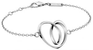 Calvin Klein Warm Heart Silver Stainless Steel Ladies Bracelet KJ5AMB000100Stylish and attractive, this Calvin Klein Warm Heart Silver Stainless Steel Ladies Bracelet KJ5AMB000100 is complete with a polished finish on a silver stainless steel bracelet. At the front of the bracelet, an entangled heart pendant can be found. Working through the chain link to the other side of the bracelet, an ever present Calvin Klein logo can be found and fastened with a lobster claw clasp. This bracelet cosily fits into the Warm collection. Key Features:Warm CollectionSilver Stainless SteelHeart PendantLobster Claw ClaspsPolished Finish The Brand: Calvin KleinCalvin Klein is one of the truly iconic cultural forces to emerge from the twentieth century. Based on bold, progressive thinking and seductively minimal aesthetic, the company was founded as a Manhattan coat shop by its namesake in 1968, and has since become a global lifestyle phenomenon. In line with this design mission is Calvin Klein's range of timepieces. Defined by their trademark simplicity and constantly evolving to match contemporary trends, the collection allows the wearer to sport a fashion legend proudly on their wrist.