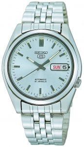 Seiko 5 Automatic Silver Dial Stainless Steel Men's Watch SNK355K1This Seiko 5 White Dial Stainless Steel Men's Watch (SNK355K1) is driven by a 21-jewel automatic movement, it is a classic addition to the Seiko 5 family. The 21 jewel movement improves the accuracy of the watch, through the placement of two a ruby between two moving parts to reduce the wearing. A sleek silver stainless steel case and mineral glass protects the dial.Key Features:Exclusive Seiko 7S36 Calibre21-Jewel Automatic MovementLuminous Hands and MarkersOpen Case BackDay-Date WindowWater Resistant to 30mThe Family: Seiko 5The Seiko 5 family has set the standard in affordable, rugged and stylish watches since 1963. They incorporate simplicity, but seriousness. The name of the Seiko 5 derives from its five key attributes, which Seiko promised to include in every watch that belonged to the family. They are: automatic winding, displaying the day and date in a single window, water resistance, a recessed crown at the 4 o'clock position and a durable metal bracelet.1963 marked the year that the Seiko 5 acted as a catalyst in the horological revolution in automatic watchmaking. Even after being in the market for over 50 years, albeit the Seiko 5 still remains as cool and relevant as ever. Though this serves as proof that expert craftsmanship and elegant design will never go out of fashion. The Brand: SeikoCeaseless determination to innovate in every aspect of the watchmaker's art is what defines Seiko's 135-year history. By embracing this ethos, Seiko has been responsible for a string of industry-leading advances in the technology of time. Notably, the creation of the world's first quartz watch in 1969. Or equally impressive the creation of the world's first TV watch in 1982. And even more relevant today, with our abhorrent use of non-renewable energy sources, Seiko's Kinetic. This watch had the ability to generate its own power from the movement of the wearer, it was released in 1988. The listed technological developments serve as evidence to illustrate the revolutionary impact which Seiko has had on the watchmaking world. They are also markably unique in that they manufacture every aspect of every watch in-house. They even grow their own quartz crystals and sapphires, hence why Seiko are renowned for being watchmaking experts.If you have any questions please click hereClick here to join our facebookand Instagram!