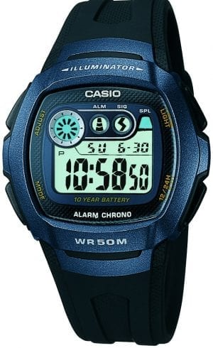 "Casio was established in 1946 by Japanese engineer Tadao Kashio. The company's first major product couldn't be further from the world of consumer electronics in which it is now a global force; it was a finger ring that allowed the wearer to smoke a cigarette right down to the filter without the risk of burning their finger. As cigarettes were highly valuable in post-Second World War Japan, the invention was a success, and Kashio and his younger brothers decided to use all the proceeds to develop their own range of calculators. The brothers produced their first desk-sized calculator in 1954, but it wasn't until Casio's release of the world's first all-electronic compact calculator in 1957 that the company truly announced itself on the world stage. Within just twelve years, Casio had opened a European office in Zurich, entered the US and Canadian markets and, such was the demand for their products, been forced to build two dedicated manufacturing plants. Calculators became so popular in Japan that from 1965-70 production doubled each year, with the market exceeding 100 billion yen in total value by 1970. Competition became fierce, and the period is now known in Japan as the ""calculator wars."" Casio took a decisive step in winning this ""war"" in 1972 with the release of the affordable, incredibly well-made and as a result highly popular, Casio Mini. This established the company firmly  at the top of the consumer electronics world, allowing them to diversify and enter the timepiece market in 1974 with the release of the Casiotron, the world's first Auto Calendar watch. While calculators and watches may nowadays appear to be worlds apart, the 1970s saw a radical shift from mechanical to quartz mechanisms, with these revolutionary new rapidly oscillating crystal movements requiring what is essentially a simple adding machine that shows a running calculation of each second. Thanks to its decade of electronic calculator innovation, Casio was already well stocked with the exact technology that these new movements required, and therefore rapidly gained traction in the global timepiece market. Only eleven years after entering this field, Casio completely reshaped global thought about the function a watch should perform with the release of the pioneering and now legendary G-Shock family. Flying in the face of the growing trend among manufacturers for the production of the thinnest, most delicate watch possible, Casio designed the G-Shock to be so robust and durable that it could comfortably survive being dropped from a building. Due to its unique appearance, the watch was originally only popular in the US, but in the years that have followed it has now become Casio's signature timepiece. Innovation and world firsts have defined the company's history ever since, the most striking of these being the release of the first ever touch screen watch in 1991, 24 years before the Apple Watch, and the first ever wrist camera watch in 2000. In short, Casio was producing smartwatches decades before the term had even been coined. Add to this the hipster popularity of the company's retro designs, and Casio has firmly cemented its reputation as a famously reliable and precise name in both analog and digital watches. The Casio Classic Collection includes some the most iconic watches the company has ever made. Popular today due to their retro appeal, refreshingly simple practicality, and understated styling, the Casio Classic Collection of timepieces are truly timeless and appeal to an almost uniquely broad range of people; proof that some things genuinely never go out of style. This Casio Classic Black and Blue Men's Alarm Chronograph (W-210-1BVES) has a digital display protected by a blue resin case and scratch-resistant mineral glass. Featuring a stopwatch, the ability to set a daily alarm, an auto calendar, a 10-year battery life and a second time zone function, the watch is fitted with a black resin strap and water resistant to 5ATM. WatchNation is proud to be an authorized, established and respected supplier of Casio watches. We stock a broad and exciting range of these superb timepieces both online and in store. Visiting us in store, located at 15-17 Charles Street, Hoole, Chester, CH2 3AZ, gives you the opportunity to take a first-hand look at our fantastic range of high-quality timepieces, with our friendly team of staff always on hand to use their decades of experience to offer helpful advice, useful information and expert guidance. If you can't pay a visit to our store, then our online delivery service guarantees that your latest timepiece will go from checkout to your wrist in a fast and reliable manner. These services are all a product of the motto on which WatchNation was founded and will forever operate – ""Time for the People."""