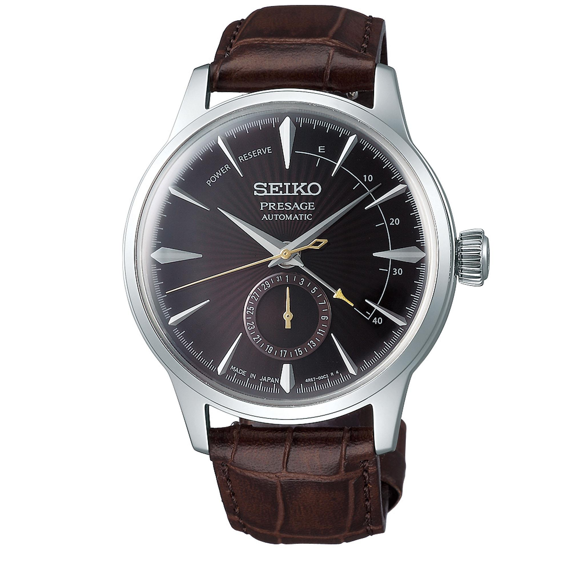 Seiko Presage Black Cat Martini Automatic Brown Leather Silver Steel Men's Watch SSA393J1This Seiko Presage Black Cat Martini Automatic Brown Leather Silver Steel Men's Watch SSA393J1 brings out the character of cocktails. Deep, rich tones, such as the fascinating purple of a Black Cat Martini sparkling and to under soft light, are the key to ths sophistacted taste. A cocktail brown dial is compimented by a silver stainless steel indexes and hands which in turn are powered by an automatic 29 jewel 4R57 movement. Above the 6 o'clock index is a subdial which shows the date with a power reserve indicator at the top right of the dial. Surrounding the dial is hardlex crystal glass and a beautiful gold PVD stainless steel case. Finally, a stitched brown leather strap can be fastened using a three fold clasp.This watch has a water resistance of 50 metres, making it suitable for surface swimming.For all you Seikoenthusiasts, this premium timepiece has been made and produced in Japan, indicated by the suffix 'J'. Seiko watches made in Japan are notoriously hard to obtain outside of Japan due to the highest quality of craftmanship and astonishing features that come in each individual timepiece. We have a range of Japanese watches here at Watchnation but in limited quantities, so if you are looking to add to your collection then this is the perfect place for you.Key Features:29 JewelsPresage FamilyBlack Cat Martini InspiredBrown DialSilver Stainless Steel CaseBrown Leather StrapDate SubdialAutomatic Movement50m Water ResistantHardlex Crystal Glass+-45 Seconds Per DayThree Fold Clasp23 JewelsPower Reserve41 Hour Power Reserve4R57 CaliberThe Brand: SeikoSeiko's 135-year history has been marked by a ceaseless determination to innovate in every aspect of the watchmaker's art. By embracing this mantra, Seiko has been responsible for a string of industry-leading advances in the technology of time, such as the world's first quartz watch, the world's first TV watch, and the Seiko Kine