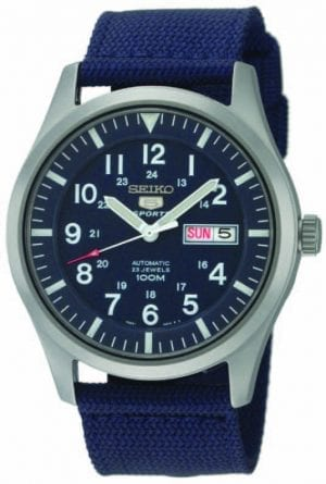 Seiko 5 Sports Automatic Military Blue Canvas Mens Watch SNZG11K1 42mmDriven by a 21-jewel automatic movement, this Seiko 5 Sports Automatic Mens Watch SNZG11K1 42mm has military feel to it with a blue canvas strap. In terms of the blue dial, the ever present Seiko 5 sits just below the 12 o'clock index with a day and date display taking the place of the 3 o'clock position. Working outwards, the watch accomodates 12 and 24 hour indexes to suit the needs of both. This blue dial is protected by a silver stainless steel case and hardlex crystal glass.This timepiece has a water resistancy of 100 metres, meaning it can be used for both swimming and snorkeling but should not be subjected to any signifcant depths. Key Features: Exclusive 77S36B Calibre Engine23 Jewel Automatic MovementLuminous Hands & MarkersOpen Case BackDay/Date Display100m Water ResistantBlue Nylon StrapLumibrite Hands & IndexesHardlex Crystal GlassDark Blue Dial12/24 Hour Display The Family: Seiko 5The Seiko 5 family has set the standard in affordable, rugged and stylish watches since 1963. Designed to be simple but serious, the Seiko 5 is so-called due to its five key attributes: automatic winding, displaying the day and date in a single window, water resistance, a recessed crown at the 4 o'clock position and a durable metal bracelet. Released in order to meet the demands of the revolutionary baby-boomer generation, the Seiko 5 collection is just as popular to this day, proof that expert craftsmanship and elegant design will never go out of fashion. The Brand: SeikoSeiko's 135-year history has been marked by a ceaseless determination to innovate in every aspect of the watchmaker's art. By embracing this mantra, Seiko has been responsible for a string of industry-leading advances in the technology of time, such as the world's first quartz watch, the world's first TV watch, and the Seiko Kinetic, the first watch ever to generate its own electricity from the movement of the wearer. Seiko are unique in that they manufacture every aspect of every watch in-house, with this ruthless pursuit of perfection even including growing their own quartz crystals and sapphires.