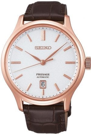 Seiko Presage Zen Garden Rose Gold Stainless Steel White Dial Automatic Men's Watch SRPD42J1 42mmThis Seiko Presage Zen Garden Rose Gold Stainless Steel White Dial Automatic Men's Watch SRPD42J1 42mm is inspired by beautiful Japanese gardens, introducing dials in calming new colours with a delicate pressed pattern. The pattern on the white dial resembles that of a marble pathway or statue in a garden. There is a simplistic date window adjacent to the 6 o'clock index. The rose gold hands are powered by an automatic 4R35 23 jewel movement. The dial is protected by a rose gold PVD stainless steel case and sapphire crystal glass. Finally, a brown leather strap is fastened using a push button clasp.This watch has a water resistance of 30 metres, making it suitable for light splashes.For all you Seiko enthusiasts, this premium timepiece has been made and produced in Japan, indicated by the suffix 'J'. Seiko watches made in Japan are notoriously hard to obtain outside of Japan due to the highest quality of craftmanship and astonishing features that come in each individual timepiece. We have a range of Japanese watches here at Watchnation but in limited quantities, so if you are looking to add to your collection then this is the perfect place for you.Key Features:Presage FamilyZen Garden StyleAutomatic MovementWhite DialBrown Leather Strap4R35 Calibre Engine+-45 Seconds Per DayRose Gold PVD Stainless Steel CaseDate DisplaySapphire Crystal GlassPush Button Deployment30m Water Resistant23 Jewels The Brand: SeikoSeiko's 135-year history has been marked by a ceaseless determination to innovate in every aspect of the watchmaker's art. By embracing this mantra, Seiko has been responsible for a string of industry-leading advances in the technology of time, such as the world's first quartz watch, the world's first TV watch, and the Seiko Kinetic, the first watch ever to generate its own electricity from the movement of the wearer. Seiko are unique in that they manufacture every aspect of every watch in-house, with this ruthless pursuit of perfection even including growing their own quartz crystals and sapphires.