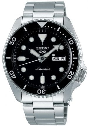 Seiko 5 Sports Black Dial Silver Stainless Steel Bracelet Automatic Men's Watch SRPD55K1Part of the new 2019 Seiko 5 sports range, this Seiko 5 Sports Watch SRPD55K1 comes in a stylish style. Firstly, a black dial is complimented by silver indexes and hands powered by a strong automatic movement. This type of engine provides an accuracy rating of +45 to -35 seconds per day. The power reserve for this calibre is around the 40 hour mark, allowing you to take it off for the weekend.Furthermore, when the crown is pulled out a hack feature means that the second hand will come to a stop. The hands and indexes are coated in a LumiBrite material which allows for easy visibility at night. Additionally, the new Seiko 5 Sports logo can be found at the 12 o'clock position which resembles the Superman logo with a blend of the '5' and the 'S'. Moreover, working clockwise, at the 3 o'clock position is a simplistic white and black day and date dial which can be displayed in English or French. Additionally, the movement of automatic is labelled by the 6 o'clock position in fancy writing which brings out the stylish side of this timepiece.The dial is protected by a thick stainless steel case as well as hardlex crystal glass to provide the protection it deserves. Also, a black bezel sits on-top of the case in increments of ten. The crown can be found at the 4 o'clock position with a raised shield to prevent it being knocked out of place. On the flip side is a open case back which allows you to see all the features and intricate workings of the watch. Then asilver stainless steel bracelet can be fastened using a three fold clasp.Finally, this watch has a water resistance of 100 metres, making it suitable for swimming and snorkelling.Key Features:5 Sports FamilyBlack DialSilver Stainless Steel CaseSilverStainless Steel BraceletAutomatic MovementCaliber 4R36Manual Winding Capacity+-45 Seconds Per DayApprox. 41 Hour DurationHardlex CrystalLumiBrite100m Water ResistantScrew Case BackSee-Th
