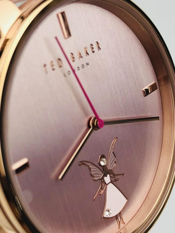 "Ted Baker Kate Fairy Pink Leather Strap Ladies' Watch TE15162004 RRP £135.00Part of the popular Kate family, this Ted Baker Kate Fairy Pink Leather Strap Ladies' Watch (TE15162004). Featuring a charming crystal-embossed fairy on the dial, the watch also has a smooth pink leather strap and a PVD rose gold-plated case. Key Features:Quartz MovementPVD Rose Gold-Plated CaseCrystal-Embossed Fairy DialSmooth Pink Leather Strap50m water Resistancy The Brand: Ted BakerBeginning as a shirt specialist in Glasgow in 1987, Ted Baker continues to operate under its founding ethos: ""No ordinary designer label."" This approach is evident in the brand's timepiece output, as each model has a unique sense of individuality woven into its make-up. A timeless name in British fashion, Ted Baker is sure to offer something to suit all tastes."