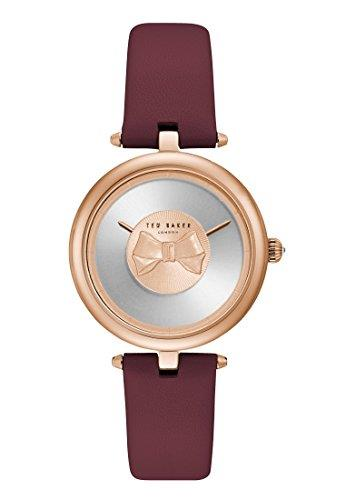 "Ted Baker Andrea Silver Dial Purple Leather Strap Ladies' Watch TE15199004This Ted Baker Andrea Purple Leather Strap Ladies' Watch (TE15199004) is the perfect combination of bold and minimal styling. Defined by the bow at the centre of the strikingly bare dial, the watch also features a smooth purple leather strap and a precise and reliable quartz movement.  Key Features:Quartz MovementPVD Rose Gold-Plated CaseMarker-Less DialSmooth Leather Strap30m Water Resistancy2 Year Guarantee The Brand: Ted BakerBeginning as a shirt specialist in Glasgow in 1987, Ted Baker continues to operate under its founding ethos: ""No ordinary designer label."" This approach is evident in the brand's timepiece output, as each model has a unique sense of individuality woven into its make-up. A timeless name in British fashion, Ted Baker is sure to offer something to suit all tastes."