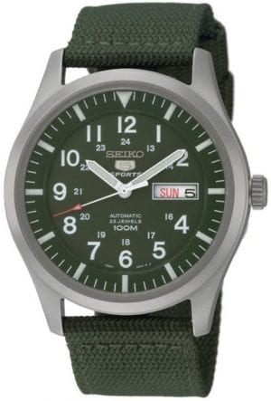 Seiko 5 Sports Automatic Military Khaki Green NATO Canvas Strap Men's WatchDriven by a 23 jewel automatic movement, this Seiko 5 Sports Automatic Military Khaki Green NATO Canvas Strap Men's Watch pairs legendary Seiko 5 reliability and precision with military style khaki green canvas strap. the green colour scheme is continued within the dial with a Seiko 5 logo sitting below the 12 o'clock index and a day and date window taking the place of the 3 o'clock index. Around the edge of the dial are indexes for both 12 and 24 hour displays, suiting the needs of both. This simplistic dial is protected by a silver stainless steel case and hardlex crystal glass.This timepiece has a water resistancy of 100 metres, making it suitable for swimming but should not be submerged to any considerable amount.Key Features:Seiko 7S26 Calibre Engine23 Jewel Automatic MovementOpen Case BackDay/Date WindowKhaki Green Canvas Strap100m Water ResistantDark Green DialSilver Stainless Steel Case12/24 Hour DisplayAnalogue DisplayHardlex CrystalPull/Push CrownBuckle ClaspThe Family:The Seiko 5 family has set the standard in affordable, rugged and stylish watches since 1963. They incorporate simplicity, but seriousness. The name of the Seiko 5 derives from its five key attributes, which Seiko promised to include in every watch that belonged to the family. They are: automatic winding, displaying the day and date in a single window, water resistance, a recessed crown at the 4 o'clock position and a durable metal bracelet.1963 marked the year that the Seiko 5 acted as a catalyst in the horological revolution in automatic watchmaking. Even after being in the market for over 50 years, albeit the Seiko 5 remains as cool and relevant as ever. Though this serves as proof that expert craftsmanship and elegant design will never go out of fashion.The Brand: SeikoCeaseless determination to innovate in every aspect of the watchmaker's art is what defines Seiko's 135-year history. By embracing this ethos, Seik