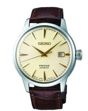 Seiko Presage Cocktail Automatic Brown Calf Leather Strap Mens Watch SRPC99J1 40.5mmThe watches dial features a golden champagne like colour perfected by the experts in Seiko's facilities located in Japan, offering high quality and value. The display includes three hands, those of which are hour, minute and second hands. A date window is located just to the left of the 3 o'clock position with the ever present Seiko logo appearing at 12 o'clock. The epic timepiece is paired with a brown calfskin leather strap and a three fold clasp with push button release. This automatic movement also has a manual wind feature. The dial is protected by a hardlex crystal glass. All in all, this makes for a perfect dress watch. For all you Seiko enthusiasts, this premium timepiece has been made and produced in Japan, indicated by the suffix 'J'. Seiko watches made in Japan are notoriously hard to obtain outside of Japan due to the highest quality of craftmanship and astonishing features that come in each individual timepiece. We have a range of Japanese watches here at Watchnation but in limited quantities, so if you are looking to add to your collection then this is the perfect place for you. Key Features:50m Water ResistantGolden Champagne DialDate Display at 3 o'clock PositionHardlex CrystalBuckle ClaspAutomatic MovementCaliber: 4R3523 Jewels41 Hour Power Reserve The Brand: SeikoSeiko's 135-year history has been marked by a ceaseless determination to innovate in every aspect of the watchmaker's art. By embracing this mantra, Seiko has been responsible for a string of industry-leading advances in the technology of time, such as the world's first quartz watch, the world's first TV watch, and the Seiko Kinetic, the first watch ever to generate its own electricity from the movement of the wearer. Seiko are unique in that they manufacture every aspect of every watch in-house, with this ruthless pursuit of perfection even including growing their own quartz crystals and sapphires.