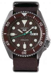 Seiko 5 Sports Stainless Steel Case Brown Canvas Strap Automatic Men's Watch SRPD85K1Part of the new 2019 Seiko 5 sports range, this Seiko 5 Sports Watch SRPD85K1 comes in a stylish style. Firstly, a brown dial is complimented by silver indexes and hands powered by a strong automatic movement. This type of engine provides an accuracy rating of +45 to -35 seconds per day. The power reserve for this calibre is around the 40 hour mark, allowing you to take it off for the weekend.Furthermore, when the crown is pulled out a hack feature means that the second hand will come to a stop. The hands and indexes are coated in a LumiBrite material which allows for easy visibility at night. Additionally, the new Seiko 5 Sports logo can be found at the 12 o'clock position which resembles the Superman logo with a blend of the '5' and the 'S'. Moreover, working clockwise, at the 3 o'clock position is a simplistic white and black day and date dial which can be displayed in English or French. Additionally, the movement of automatic is labelled by the 6 o'clock position in fancy writing which brings out the stylish side of this timepiece.The dial is protected by a thick stainless steel case as well as hardlex crystal glass to provide the protection it deserves. Also, a brown bezel sits on-top of the case in increments of ten. The crown can be found at the 4 o'clock position with a raised shield to prevent it being knocked out of place. On the flip side is a open case back which allows you to see all the features and intricate workings of the watch. Then abrown canvas strap can be fastened using a standard buckle.Finally, this watch has a water resistance of 100 metres, making it suitable for swimming and snorkelling.Key Features:5 Sports FamilyBrown DialSilver Stainless Steel CaseBrown Canvas StrapAutomatic MovementCaliber 4R36Manual Winding Capacity+-45 Seconds Per DayApprox. 41 Hour DurationHardlex CrystalLumiBrite100m Water ResistantScrew Case BackSee-Through Case BackUnidirectional