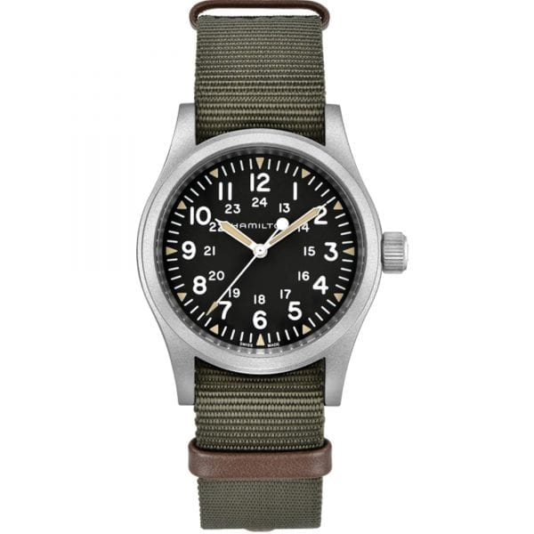 """Hamilton 1960s Re-Creation Khaki Field Mechanical Mens Watch H69439931 38mmBased on the 1960's model, this Hamilton1960s Re-Creation Khaki Field Mechanical Mens Watch H69439931 38mm isa stunning iteration to the Khaki Field family, bringing out Hamiltons military heritage. The dial has a 12 and 24 hour display which in turn are luminescent, allowing visibility for nighttime operations.Also on the black dial is the Hamilton logo which can be found underneath the 12 o'clock position. This dial is protected by a silver stainless steel case and sapphire crystal glass. A durable khaki NATO strap is fastened to sit comfortably around ones wrist.This watch has a water resistance rating of 50 metres, making it suitable for surface swimming but should not be submerged to any significant depths.Key Features:Khaki Field Mechanical FamilySilver Stainless Steel CaseThree Hand DisplayNATO StrapSapphire Crystal GlassMechanical Movement50m Water ResistantThe Brand: HamiltonSince its foundation in 1892, Hamilton Watch Company have developed a reputation for being a provider of accurate timekeeping. Hence they earned the title of """"The Watch of Railroad Accuracy"""", as a result of their highly accurate pocket watches.Hamilton earned a place in history, as they found themselves suppliers of watches to the US military in both world wars.The US Naval Lab invited the Hamilton Watch Company to create an American made chrono.There was a shortage of chronos available to the US Government during the First World War. Therefore they had to rely solely on European made pieces.For this reason Hamilton agreed in 1941 to undertake the work. Moreover, by 1944 Hamilton had produced more than 10,000 Chronometers in aid of the American War effort.Hamilton have developed a close relationship over the years with Hollywood. Hamilton watches have featured in over 450 films, beginning in 1951 with the Frogman watch. Other films include: Elvis Presley in 1961's 'Blue Hawaii' and in '2001: A Space Odyssey'. Fur"""