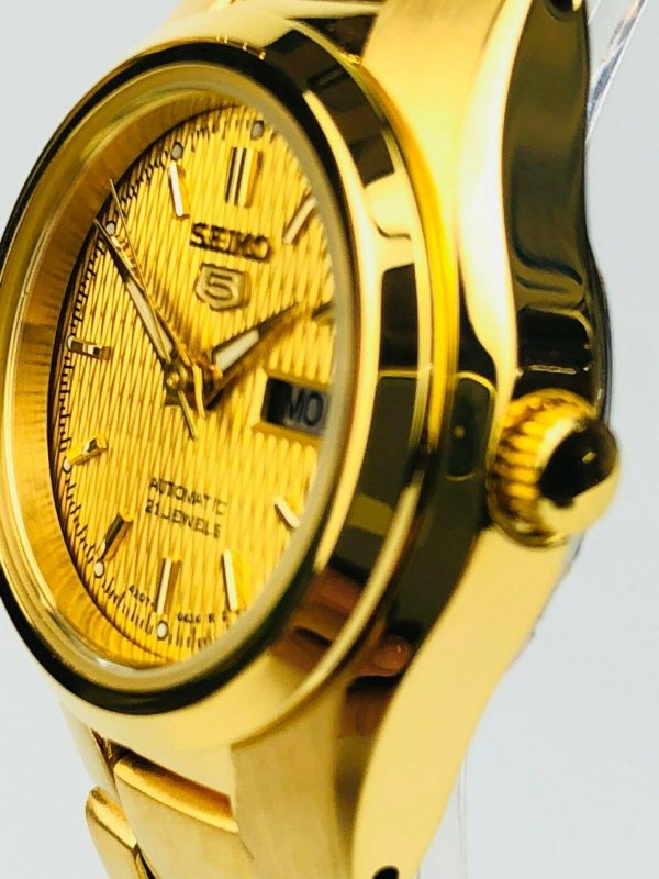 Seiko 5 Automatic Gold PVD Stainless Steel Ladies WatchDriven by a 21-jewel automatic movement, this Seiko 5 Automatic Gold PVD Stainless Steel Ladies Watch has an exclusive Seiko 7S26 engine. Starting with the dial, the ever present Seiko logo can be found just below the 12 o'clock position. Firstly, at the 3 o'clock position is a simplistic day and date window making for easy reading. Furthermore, around the edges of the dial are index markers coated in a luminous material for visibility at night. Moreover, this dial is protected by a silver stainless steel case and hardened mineral glass. To equip this timepiece, a gold PVD stainless steel bracelet is fastened using a deployment clasp to sit comfortably around ones wrist.This watch has a water resistance rating of 30 metres, meaning it can be subjected to light splashes but should not be used for swimming.Key Features:7S26 Calibre21 JewelAutomatic MovementOpen Case BackDay and Date WindowGold PVD Stainless Steel Case and BraceletSplash ResistantGold DialFold Over ClaspThe Family: Seiko 5The Seiko 5 family has set the standard in affordable, rugged and stylish watches since 1963. They incorporate simplicity, but seriousness. The name of the Seiko 5 derives from its five key attributes, which Seiko promised to include in every watch that belonged to the family. They are: automatic winding, displaying the day and date in a single window, water resistance, a recessed crown at the 4 o'clock position and a durable metal bracelet.1963 marked the year that the Seiko 5 acted as a catalyst in the horological revolution in automatic watchmaking. Even after being in the market for over 50 years, albeit the Seiko 5 still remains as cool and relevant as ever. Though this serves as proof that expert craftsmanship and elegant design will never go out of fashion.The Brand: SeikoCeaseless determination to innovate in every aspect of the watchmaker's art is what defines Seiko's 135-year history. By embracing this ethos, Seiko has been responsible for a string of industry-leading advances in the technology of time. Notably, the creation of the world's first quartz watch in 1969. Or equally impressive the creation of the world's first TV watch in 1982. And even more relevant today, with our abhorrent use of non-renewable energy sources, Seiko's Kinetic. The listed technological developments serve as evidence to illustrate the revolutionary impact which Seiko has had on the watchmaking world. They are also markably unique in that they manufacture every aspect of every watch in-house.If you have any questions please click hereClick here to join our facebook and Instagram!