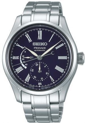Seiko Presage Blue Enamel Silver Stainless Steel Blue Dial Automatic Men's Watch SPB091J1 41mmThisSeiko Presage Blue Enamel Silver Stainless Steel Blue Dial Automatic Men's Watch SPB091J1 41mm is inspired by the sky at night and Japan's fascination with the moon. This watch combines Seiko's mechanical watchmaking and Japanese craftmanship in the form of enamel. The crescent moon on the reverse end of the second hand moves gracefully across the blue dial, just as the moon moves across the night sky in the high mountains of Japan. Underneath the 12 o'clock position is the ever present Seiko logo with a date subdial on the opposite end of the dial. Adjacent to the 9 o'clock position is a power reserve indicator to show you how many hours power you have left. Around the edge of the dial are white Roman numeral indexes. Surronding the twilight inspired dial is a silver stainless steel case and sapphire crystal glass. Finally, a silver stainless steel bracelet can be fastened using a three fold clasp and released with a push button.This watch has a water resistance of 100 metres, making it suitable for swimming and snorkeling.For all you Seikoenthusiasts, this premium timepiece has been made and produced in Japan, indicated by the suffix 'J'. Seiko watches made in Japan are notoriously hard to obtain outside of Japan due to the highest quality of craftmanship and astonishing features that come in each individual timepiece. We have a range of Japanese watches here at Watchnation but in limited quantities, so if you are looking to add to your collection then this is the perfect place for you.Key Features:Presage FamilyBlue Enamel DialAutomatic Movement6R27 Calibre Engine+-25 Seconds Per Day45 Hour DurationSilver Stainless Steel CaseSapphire Crystal GlassAnti-Reflective CoatingThree Fold ClaspPush Button Release100m Water ResistantScrew Case BackSeethrough Case Back29 JewelsDate DisplayMagnetic ReluctancePower Reserve DisplayThe Brand: SeikoSeiko's 135-year history has been 