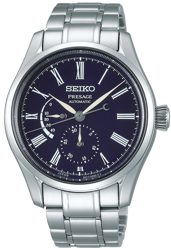 Seiko Presage Blue Enamel Silver Stainless Steel Blue Dial Automatic Men's Watch SPB091J1 41mmThis Seiko Presage Blue Enamel Silver Stainless Steel Blue Dial Automatic Men's Watch SPB091J1 41mm is inspired by the sky at night and Japan's fascination with the moon. This watch combines Seiko's mechanical watchmaking and Japanese craftmanship in the form of enamel. The crescent moon on the reverse end of the second hand moves gracefully across the blue dial, just as the moon moves across the night sky in the high mountains of Japan. Underneath the 12 o'clock position is the ever present Seiko logo with a date subdial on the opposite end of the dial. Adjacent to the 9 o'clock position is a power reserve indicator to show you how many hours power you have left. Around the edge of the dial are white Roman numeral indexes. Surronding the twilight inspired dial is a silver stainless steel case and sapphire crystal glass. Finally, a silver stainless steel bracelet can be fastened using a three fold clasp and released with a push button.This watch has a water resistance of 100 metres, making it suitable for swimming and snorkeling.For all you Seiko enthusiasts, this premium timepiece has been made and produced in Japan, indicated by the suffix 'J'. Seiko watches made in Japan are notoriously hard to obtain outside of Japan due to the highest quality of craftmanship and astonishing features that come in each individual timepiece. We have a range of Japanese watches here at Watchnation but in limited quantities, so if you are looking to add to your collection then this is the perfect place for you.Key Features:Presage FamilyBlue Enamel DialAutomatic Movement6R27 Calibre Engine+-25 Seconds Per Day45 Hour DurationSilver Stainless Steel CaseSapphire Crystal GlassAnti-Reflective CoatingThree Fold ClaspPush Button Release100m Water ResistantScrew Case BackSeethrough Case Back29 JewelsDate DisplayMagnetic ReluctancePower Reserve Display The Brand: SeikoSeiko's 135-year history has been marked by a ceaseless determination to innovate in every aspect of the watchmaker's art. By embracing this mantra, Seiko has been responsible for a string of industry-leading advances in the technology of time, such as the world's first quartz watch, the world's first TV watch, and the Seiko Kinetic, the first watch ever to generate its own electricity from the movement of the wearer. Seiko are unique in that they manufacture every aspect of every watch in-house, with this ruthless pursuit of perfection even including growing their own quartz crystals and sapphires.