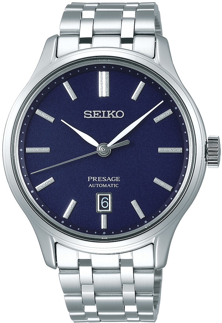 Seiko Presage Zen Garden Silver Stainless Steel Blue Dial Automatic Men's Watch SRPD41J1 42mmThis Seiko Presage Zen Garden Silver Stainless Steel Blue Dial Automatic Men's Watch SRPD41J1 42mm is inspired by beautiful Japanese gardens, introducing dials in calming new colours with a delicate pressed pattern. The pattern on the darkblue dial resembles that of a pond in the night sky.There isa simplistic date window adjacent to the 6 o'clock index. The grey hands are powered by an automatic 4R35 23 jewel movement. The dial is protected by a silver stainless steel case and sapphire crystal glass. Finally, a silver stainless steel bracelet is fastened using a push button clasp.This watch has a water resistance of 30 metres, making it suitable for light splashes.For all you Seikoenthusiasts, this premium timepiece has been made and produced in Japan, indicated by the suffix 'J'. Seiko watches made in Japan are notoriously hard to obtain outside of Japan due to the highest quality of craftmanship and astonishing features that come in each individual timepiece. We have a range of Japanese watches here at Watchnation but in limited quantities, so if you are looking to add to your collection then this is the perfect place for you.Key Features:Presage FamilyZen Garden StyleAutomatic MovementDark Blue DialSilver Stainless Steel Bracelet4R35 Calibre Engine+-45 Seconds Per DaySilver Stainless Steel CaseDate DisplaySapphire Crystal GlassPush Button Deployment30m Water Resistant23 JewelsThe Brand: SeikoSeiko's 135-year history has been marked by a ceaseless determination to innovate in every aspect of the watchmaker's art. By embracing this mantra, Seiko has been responsible for a string of industry-leading advances in the technology of time, such as the world's first quartz watch, the world's first TV watch, and the Seiko Kinetic, the first watch ever to generate its own electricity from the movement of the wearer. Seiko are unique in that they manufacture every aspect of every wa