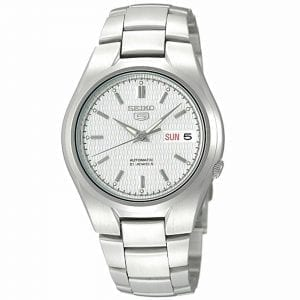 Seiko 5 Automatic White Dial Silver Stainless Steel Men's WatchDriven by a 21-jewel automatic movement, this Seiko 5 Automatic White Dial Silver Stainless Steel Men's Watch is a perfect addition to the wrist. At the 12 o'clock position is the ever present Seiko 5 logo with a day and date window at the 3 o'clock position. The hands of which are powered by an automatic movement are coated in a luminous material for easy visibility at night. Surrounding the dial is a silver stainless steel case to provide the dial with some protection. On the flip of the dial is an open case back window which allows you to see all the inner workings of the timepiece. Finally, a silver stainless steel bracelet can be fastened using a deployment clasp.This watch has a water resistance of 30 metres, making it suitable for light splashes.Key Features:Exclusive Seiko 7S26 Calibre21-Jewel Automatic MovementDay-Date WindowWater Resistant to 30mOpen Case BackWhite DialSilver Stainless SteelDeployment ClaspAnalogue DisplayThe Family:The Seiko 5 family has set the standard in affordable, rugged and stylish watches since 1963. They incorporate simplicity, but seriousness. The name of the Seiko 5 derives from its five key attributes, which Seiko promised to include in every watch that belonged to the family. They are: automatic winding, displaying the day and date in a single window, water resistance, a recessed crown at the 4 o'clock position and a durable metal bracelet.1963 marked the year that the Seiko 5 acted as a catalyst in the horological revolution in automatic watchmaking. Even after being in the market for over 50 years, albeit the Seiko 5 still remains as cool and relevant as ever. Though this serves as proof that expert craftsmanship and elegant design will never go out of fashion.The Brand: SeikoCeaseless determination to innovate in every aspect of the watchmaker's art is what defines Seiko's 135-year history. By embracing this ethos, Seiko has been responsible for a string of indu