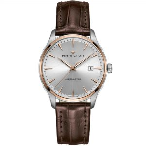 "Hamilton Jazzmaster Rose Gold Steel Case Leather Strap Mens Watch H32441551 40mmThis Hamilton Jazzmaster Rose Gold Steel Case Leather Strap Mens Watch H32441551 40mm is a stunning addition to the Hamilton brand. This metallic silver dial is complimented by rose gold stainless steel hands and indexes. Sat below the 12 o'clock position is the Hamilton logo as well as the brand name. The date window is positioned at the 3 o'clock position of the watch. Above the 6 o'clock position is the name of this timepiece, the Jazzmaster. To protect this dial, sapphire crystal glass and rose gold stainless steel case sit next to the dial. This watch also features a brown leather strap which is fastened using a deployment clasp. This watch has a water resistance of 50 metres, making it suitable to be subjected to light splashes.Key Features:Quartz Movement50m Water ResistantSapphire Crystal GlassBrown Leather StrapDate WindowSilver Coloured DialDeployment ClaspAnalogue DisplayPolished Finish The Family: JazzmasterMuch like jazz itself, the Hamilton Jazzmaster family contains several unique and outstanding variations on a theme. Ranging from pieces defined by their understated elegance and simplicity to bold statement watches, the Jazzmaster collection is as varied and as personal as the form of musical expression from which it takes its name. The Brand: HamiltonSince its foundation in 1892, Hamilton Watch Company have developed a reputation for being a provider of accurate timekeeping. Hence they earned the title of ""The Watch of Railroad Accuracy"", as a result of their highly accurate pocket watches.Hamilton earned a place in history, as they found themselves suppliers of watches to the US military in both world wars. The US Naval Lab invited the Hamilton Watch Company to create an American made chrono. There was a shortage of chronos available to the US Government during the First World War. Therefore they had to rely solely on European made pieces. For this reason Hamilton agreed in 1941 to undertake the work. Moreover, by 1944 Hamilton had produced more than 10,000 Chronometers in aid of the American War effort.Hamilton have developed a close relationship over the years with Hollywood. Hamilton watches have featured in over 450 films, beginning in 1951 with the 'Frogman' watch. Other films include: Elvis Presley in 1961's 'Blue Hawaii' and in '2001: A Space Odyssey'. Furthermore, Hamilton have featured in films such as 'Interstellar' and 'The Martian'.In 2003 Hamilton moved their headquarters to a facility in Switzerland. They are still a global force within the timepiece industry. This is because Hamilton watches offer a combination of American heritage, Swiss internal workings and a touch of Hollywood flair.If you have any questions please click hereClick here to join our facebookand Instagram!"