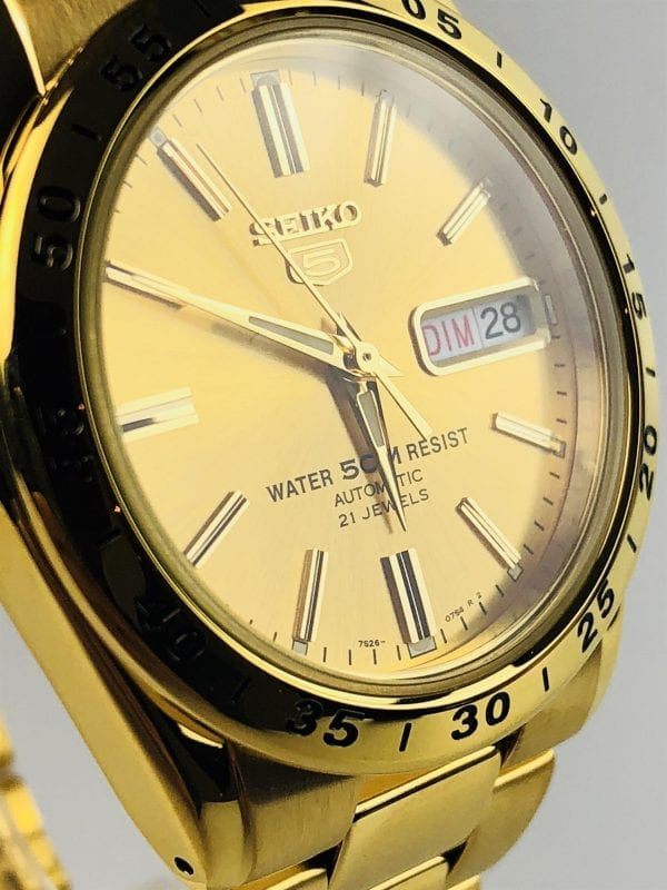 """Seiko 5 Automatic Gold Stainless Steel Men's Watch SNKE06K1This Seiko 5 Automatic Black Dial Stainless Steel Men's Watch SNKL45K1 is driven by a 21-jewel automatic movement. Also, this Seiko 5 Men's Watch SNKL45K1 features a day-date window and a sleek stainless steel bracelet and case.Key Features:Exclusive Seiko 7S26 Calibre21-Jewel Automatic MovementSeconds Counter BezelOpen Case BackDay-Date WindowWater Resistant to 50mThe Family: Seiko 5The Seiko 5 family has set the standard in affordable, rugged and stylish watches since 1963. Designed to be simple but serious, the Seiko 5 is so-called due to its five key attributes: automatic winding, displaying the day and date in a single window, water resistance, a recessed crown at the 4 o'clock position and a durable metal bracelet. Released in order to meet the demands of the revolutionary baby-boomer generation. But the Seiko 5 collection is just as popular to this day, proof that expert craftsmanship and elegant design will never go out of fashion.The Brand: SeikoSeiko's 135-year history has been marked by a ceaseless determination to innovate in every aspect of the watchmaker's art. By embracing this mantra, Seiko has been responsible for a string of industry-leading advances in the technology of time, such as the world's first quartz watch, as well as the world's first TV watch, and the Seiko Kinetic, which is the first watch ever to generate its own electricity from the movement of the wearer. Seiko are unique in that they manufacture every aspect of every watch in-house, because of their ruthless pursuit of perfection even including growing their own quartz crystals and sapphires.If you have any questions please<a title=""""https://www.watchnation.com/contact-us/Ctrl+Click or tap to follow the link"""" href=""""https://www.watchnation.com/contact-us/"""" target=""""_blank"""" rel=""""noopener noreferrer"""" data-saferedirecturl=""""https://www.google.com/url?q=https://www.watchnation.com/contact-us/&source=gmail&ust=1568209025006000&usg=AF"""