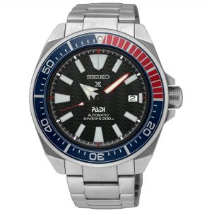 Seiko Special Prospex Automatic Divers PADI 'Pepsi Bezel' Mens Watch SRPB99K1 43.8mmPart of Seiko's Prospex series, this Seiko Special Prospex Automatic Divers PADI 'Pepsi Bezel' Mens Watch SRPB99K1 43.8mm is a stunning addition to the Prospex lineup. Starting off with the black patterned wave dial, at the 12 o'clock position is the ever present Seiko logo accompanied by the Prospex logo. Adjacent to the 3 o'clock index is a simplistic date window. Around the outside of the dial are index markers which are coated in LumiBrite to allow easy visibility at night. The hands on the dial are powered by an automatic movement (calibre engine 4R35) as well as a 41 hour power reserve. To protect this dial hardlex glass sits ontop with a stainless steel case sitting around the outside. On top of the case is a bezel nicknamed the 'Pepsi dial', due to the colour scheme of both blue and red. To equip this epic timepiece, a silver stainless steel bracelet is fastened using a three fold clasp with secure lock and push button release.This epic timepiece is perfect for those who seek the thrill of diving with a water resistance of 200 meters or 20ATM.Key Features:Prospex FamilyPADIAutomatic MovementDivers 200m Water Resistant'Pepsi Bezel'Stainless Steel CaseSilver Stainless Steel BraceletDate WindowBlack DialThree Fold Clasp4R35 CalibreHardlex Glass41 Hour Power Reserve+-45 Seconds Per DayLumiBrite23 JewelsAnalogue DisplayThe Brand: SeikoSeiko's 135-year history has been marked by a ceaseless determination to innovate in every aspect of the watchmaker's art. By embracing this mantra, Seiko has been responsible for a string of industry-leading advances in the technology of time, such as the world's first quartz watch, the world's first TV watch, and the Seiko Kinetic, the first watch ever to generate its own electricity from the movement of the wearer. Seiko are unique in that they manufacture every aspect of every watch in-house, with this ruthless pursuit of perfection even including growing their own quartz crystals and sapphires.