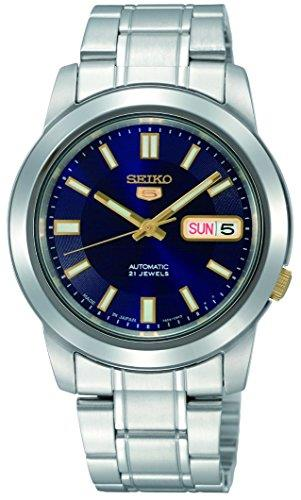Seiko 5 Automatic Blue Dial Silver Stainless Steel Men's WatchDriven by a 21-jewel automatic movement, this Seiko 5 Automatic Blue Dial Silver Stainless Steel Men's Watch is a classic addition to the Seiko 5 family. Firstly, a dark blue dial is complimented by golden indexes and hand, of which are powered by a 7S26 calibre automatic movement. Secondly, the Seiko 5 logo can be found at the 12 o'clock position with a day and date window seen at the 3 o'clock position. A silver stainless steel case surrounds the dial with hardlex crystal glass sat on-top. A silver stainless steel bracelet can then be fastened using a deployment clasp.Finally, this watch has a water resistance of 30 metres, making it suitable for light splashes.Key Features:Silver Stainless Steel Case/BraceletAutomatic MovementCaliber: 7S2621 JewelsHardlex CrystalBlue DialAnalog DisplayLuminous Hands/Indexes30m Water ResistantFold Over ClaspThe Family:The Seiko 5 family has set the standard in affordable, rugged and stylish watches since 1963. They incorporate simplicity, but seriousness. The name of the Seiko 5 derives from its five key attributes, which Seiko promised to include in every watch that belonged to the family. They are: automatic winding, displaying the day and date in a single window, water resistance, a recessed crown at the 4 o'clock position and a durable metal bracelet.1963 marked the year that the Seiko 5 acted as a catalyst in the horological revolution in automatic watchmaking. Even after being in the market for over 50 years, albeit the Seiko 5 still remains as cool and relevant as ever. Though this serves as proof that expert craftsmanship and elegant design will never go out of fashion.The Brand: SeikoCeaseless determination to innovate in every aspect of the watchmaker's art is what defines Seiko's 135-year history. By embracing this ethos, Seiko has been responsible for a string of industry-leading advances in the technology of time. Notably, the creation of the world's first 